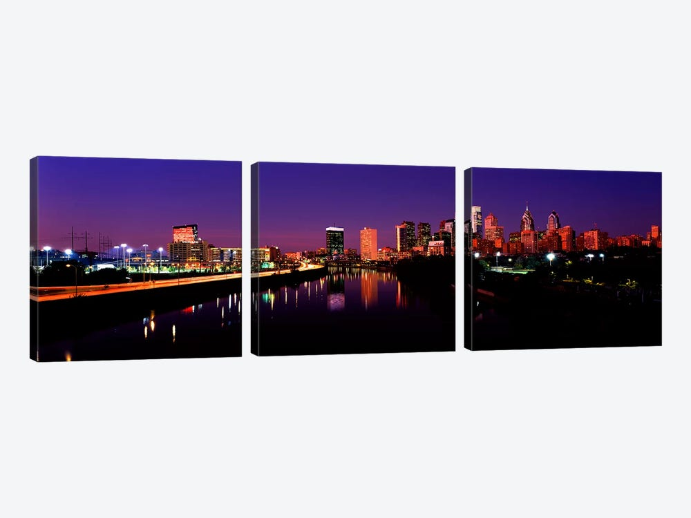 Buildings lit up at the waterfront, Philadelphia, Schuylkill River, Pennsylvania, USA by Panoramic Images 3-piece Canvas Art