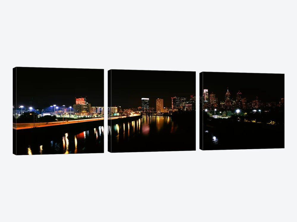 Buildings lit up at the waterfront, Philadelphia, Schuylkill River, Pennsylvania, USA #4 by Panoramic Images 3-piece Art Print