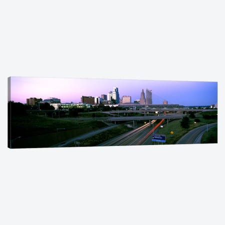Highway interchange and skyline at sunset, Kansas City, Missouri, USA Canvas Print #PIM10583} by Panoramic Images Art Print