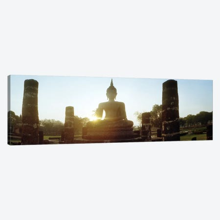Statue of Buddha at sunset, Sukhothai Historical Park, Sukhothai, Thailand Canvas Print #PIM10599} by Panoramic Images Canvas Wall Art