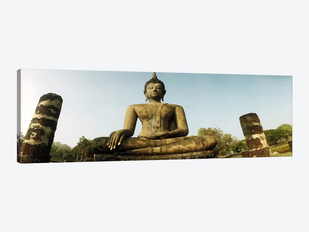 Low angle view of a statue of Buddha, Sukhothai Historical Park, Sukhothai, Thailand by Panoramic Images 1-piece Canvas Print