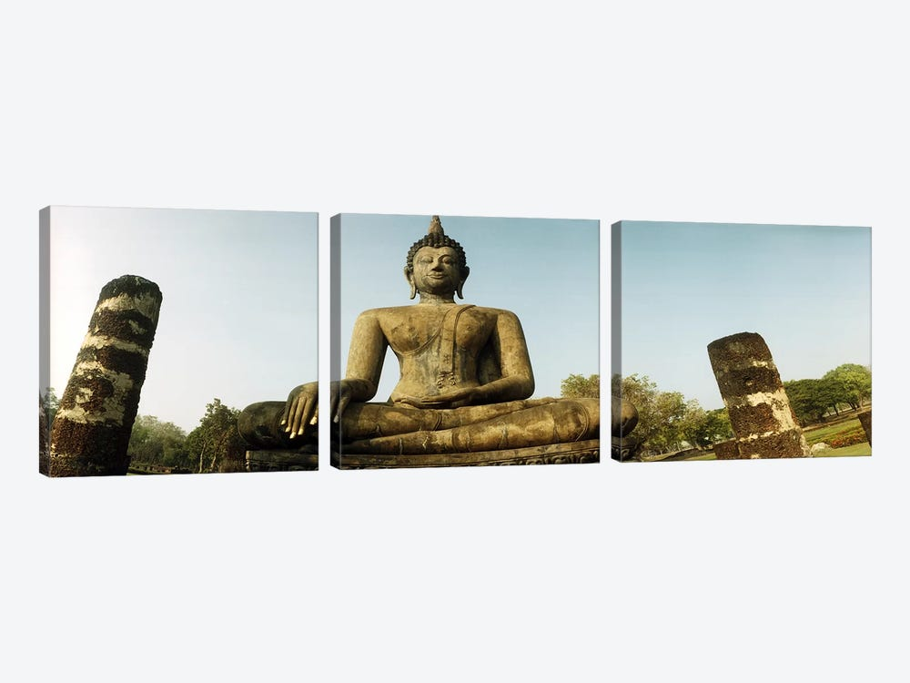 Low angle view of a statue of Buddha, Sukhothai Historical Park, Sukhothai, Thailand by Panoramic Images 3-piece Canvas Print