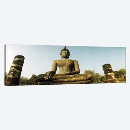 Low angle view of a statue of Buddha, Sukhothai Historical Park, Sukhothai, Thailand Canvas Print #PIM10603} by Panoramic Images Canvas Wall Art