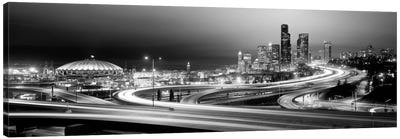 Buildings lit up at night, Seattle, Washington State, USA (black & white) Canvas Art Print