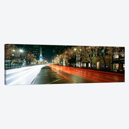 Blurred Motion Of Cars Along Michigan Avenue Illuminated With Christmas Lights, Chicago, Illinois, USA Canvas Print #PIM1066} by Panoramic Images Canvas Art