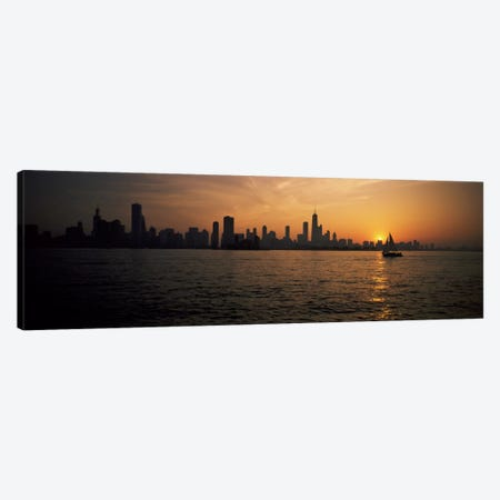 Silhouette of buildings at the waterfront, Navy Pier, Chicago, Illinois, USA Canvas Print #PIM1067} by Panoramic Images Canvas Wall Art