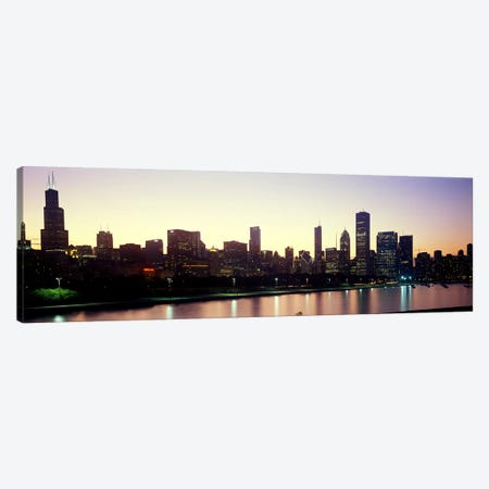 City skyline with Lake Michigan and Lake Shore Drive in foreground at dusk, Chicago, Illinois, USA Canvas Print #PIM10688} by Panoramic Images Canvas Wall Art