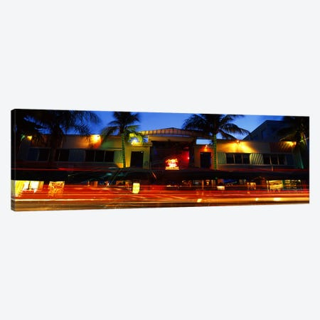 Traffic in front of a building at duskArt Deco District, South Beach, Miami Beach, Miami-Dade County, Florida, USA Canvas Print #PIM10699} by Panoramic Images Canvas Art Print