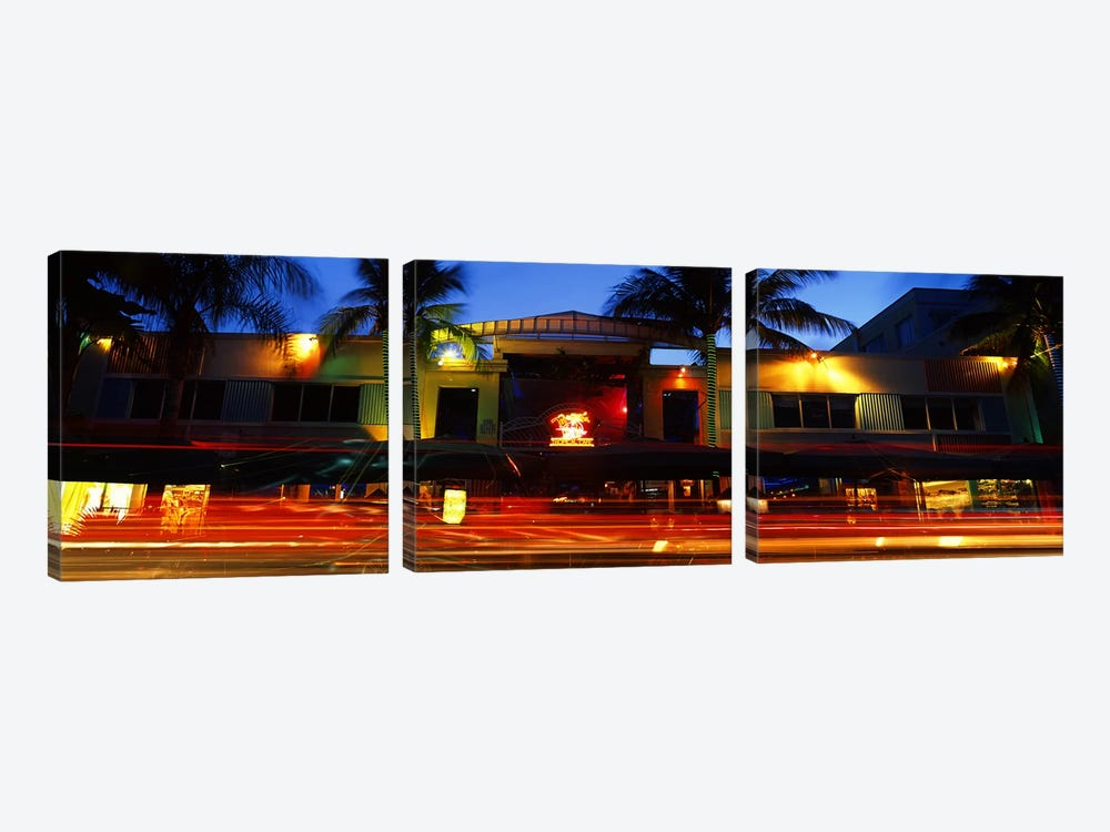 Traffic in front of a building at duskArt Deco District, South Beach, Miami Beach, Miami-Dade County, Florida, USA by Panoramic Images 3-piece Canvas Art