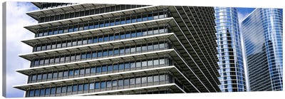 Low angle view of buildings in a city, ExxonMobil Building, Chevron Building, Houston, Texas, USA Canvas Print #PIM10754