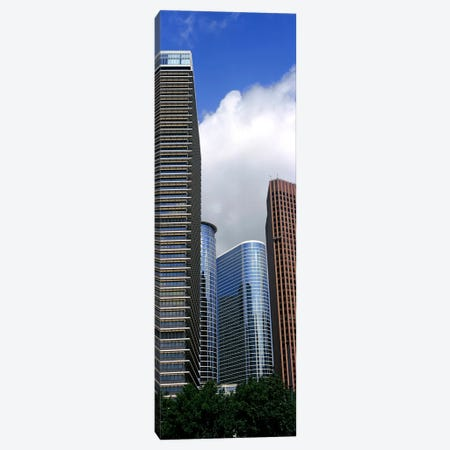 Low angle view of buildings in a city, Wedge Tower, ExxonMobil Building, Chevron Building, Houston, Texas, USA Canvas Print #PIM10758} by Panoramic Images Canvas Artwork