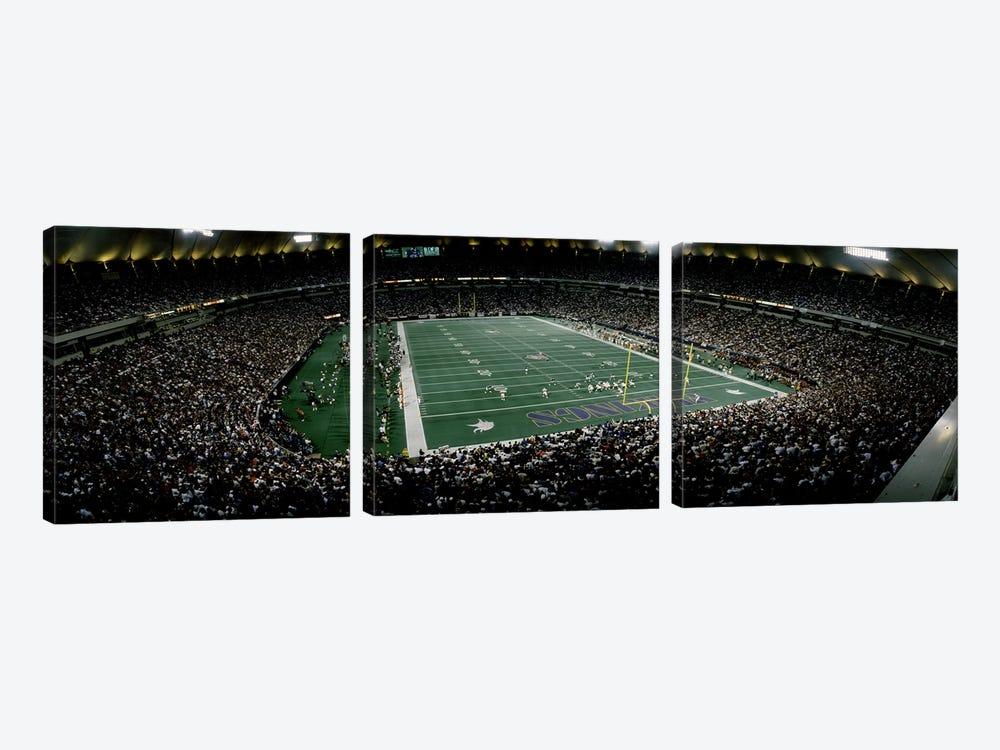Spectators in an American football stadiumHubert H. Humphrey Metrodome, Minneapolis, Minnesota, USA by Panoramic Images 3-piece Canvas Print