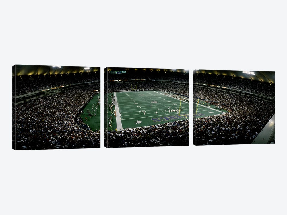Spectators in an American football stadiumHubert H. Humphrey Metrodome, Minneapolis, Minnesota, USA by Panoramic Images 3-piece Canvas Print