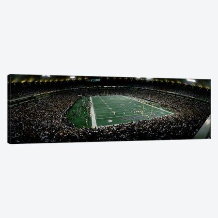 Spectators in an American football stadiumHubert H. Humphrey Metrodome, Minneapolis, Minnesota, USA Canvas Print #PIM10811} by Panoramic Images Canvas Art Print