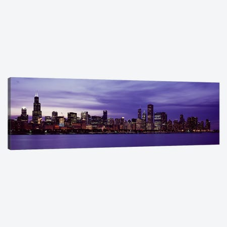 Skyscrapers in a city lit up at night, Chicago, Illinois, USA Canvas Print #PIM10852} by Panoramic Images Canvas Art Print