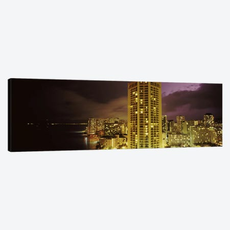 Buildings lit up at night, Honolulu, Oahu, Hawaii, USA Canvas Print #PIM10867} by Panoramic Images Art Print