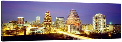 Buildings lit up at dusk, Austin, Texas, USA Canvas Art Print