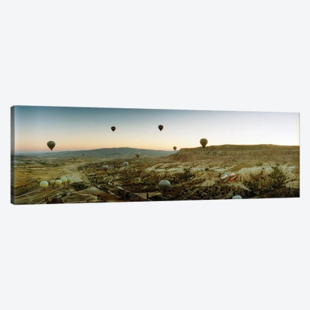 Hot air balloons over landscape at sunrise, Cappadocia, Central Anatolia Region, Turkey Canvas Print #PIM10895} by Panoramic Images Canvas Art