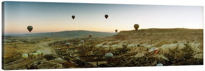 Hot air balloons over landscape at sunrise, Cappadocia, Central Anatolia Region, Turkey Canvas Art Print