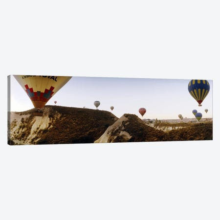 Hot air balloons over landscape at sunrise, Cappadocia, Central Anatolia Region, Turkey #2 Canvas Print #PIM10896} by Panoramic Images Canvas Wall Art