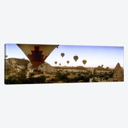 Hot air balloons over landscape at sunrise, Cappadocia, Central Anatolia Region, Turkey #3 Canvas Print #PIM10897} by Panoramic Images Canvas Art