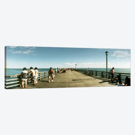 Tourists on the beach at Coney Island viewed from the pier, Brooklyn, New York City, New York State, USA Canvas Print #PIM10932} by Panoramic Images Canvas Artwork