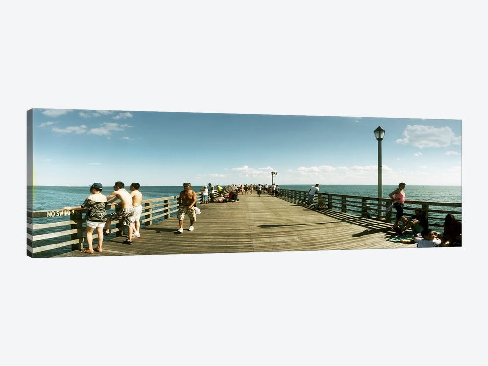 Tourists on the beach at Coney Island viewed from the pier, Brooklyn, New York City, New York State, USA by Panoramic Images 1-piece Art Print
