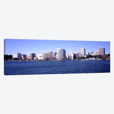 Skyscrapers in a lake, Lake Merritt, Oakland, California, USA Canvas Print #PIM10964} by Panoramic Images Canvas Artwork