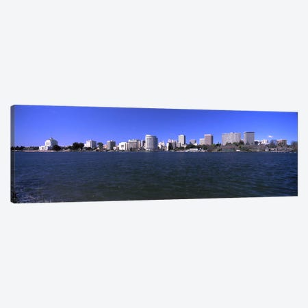 Skyscrapers along a lake, Lake Merritt, Oakland, California, USA Canvas Print #PIM10965} by Panoramic Images Canvas Art