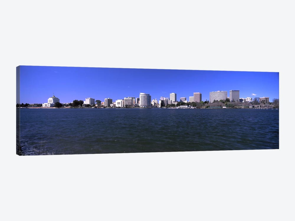 Skyscrapers along a lake, Lake Merritt, Oakland, California, USA by Panoramic Images 1-piece Art Print