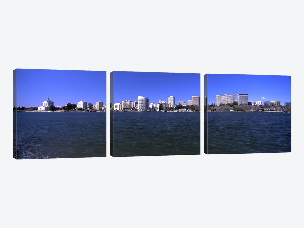 Skyscrapers along a lake, Lake Merritt, Oakland, California, USA by Panoramic Images 3-piece Canvas Print