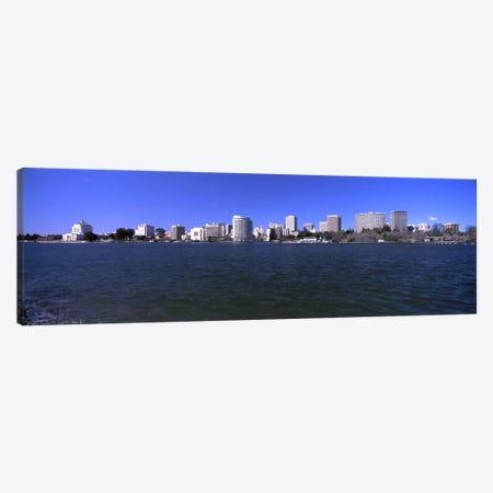 Skyscrapers along a lake, Lake Merritt, Oakland, California, USA Canvas Print #PIM10965} by Panoramic Images Canvas Art