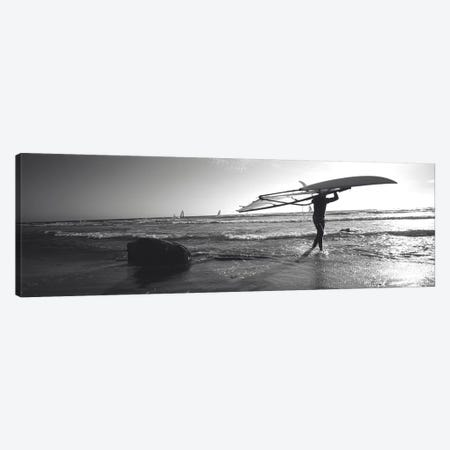 Man carrying a surfboard over his head on the beach, Santa Cruz, California, USA Canvas Print #PIM11130} by Panoramic Images Art Print