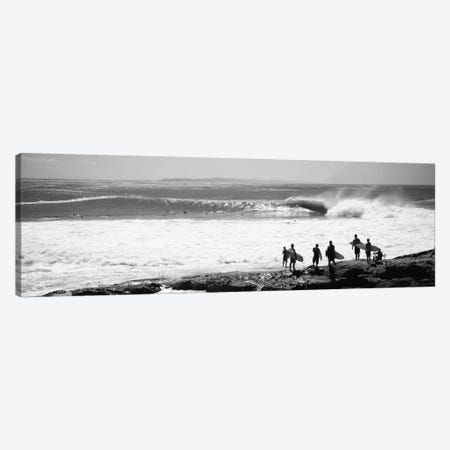 Silhouette of surfers standing on the beach, Australia Canvas Print #PIM11699} by Panoramic Images Canvas Artwork