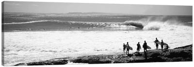 Silhouette of surfers standing on the beach, Australia Canvas Art Print