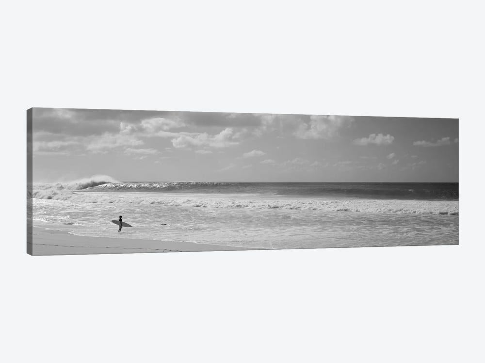 Surfer standing on the beach, North Shore, Oahu, Hawaii, USA by Panoramic Images 1-piece Canvas Wall Art