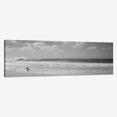 Surfer standing on the beach, North Shore, Oahu, Hawaii, USA Canvas Print #PIM11701} by Panoramic Images Canvas Wall Art