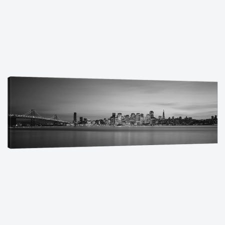 Suspension bridge with city skyline at dusk, Bay Bridge, San Francisco Bay, San Francisco, California, USA Canvas Print #PIM11762} by Panoramic Images Canvas Wall Art