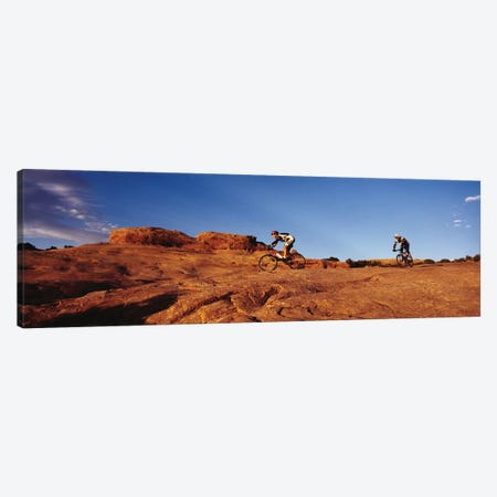 Two people mountain biking, Moab, Utah, USA Canvas Print #PIM11951} by Panoramic Images Art Print