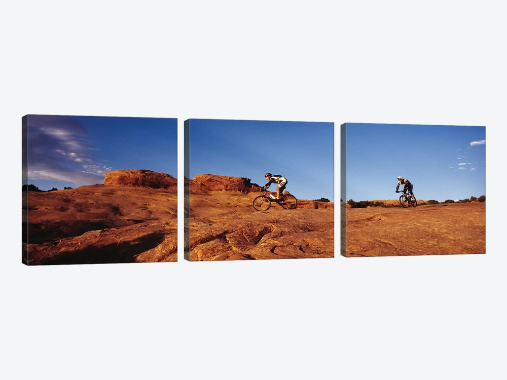 Two people mountain biking, Moab, Utah, USA by Panoramic Images 3-piece Canvas Artwork