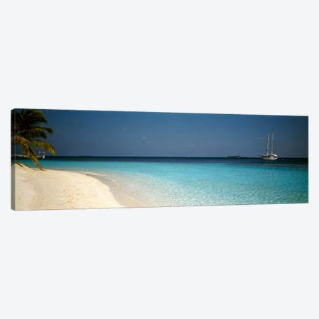 Beach & Boat Scene The Maldives Canvas Print #PIM1198} by Panoramic Images Canvas Print