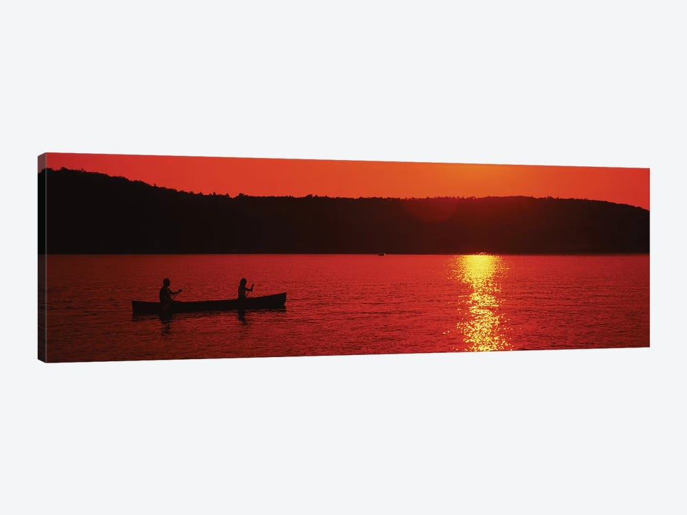 Tourists canoeing in a lake at sunset, Oquaga Lake, Deposit, Broome County, New York State, USA by Panoramic Images 1-piece Canvas Print