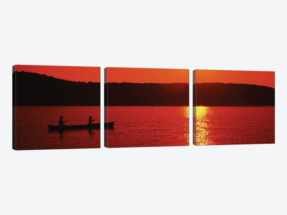 Tourists canoeing in a lake at sunset, Oquaga Lake, Deposit, Broome County, New York State, USA by Panoramic Images 3-piece Canvas Print