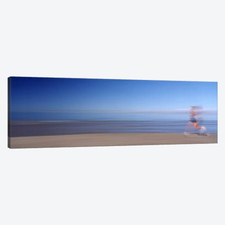 Blurred Motion Side Profile Of A Woman Running On The Beach Canvas Print #PIM12101} by Panoramic Images Canvas Artwork
