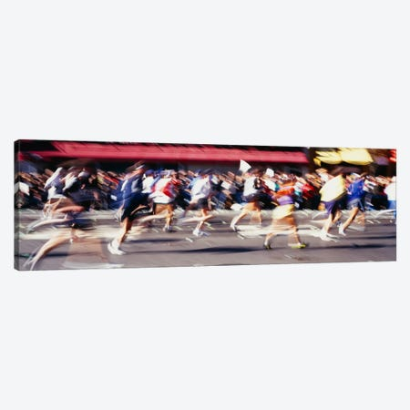 Blurred Motion Side Profile Of Marathon Runners Canvas Print #PIM12218} by Panoramic Images Canvas Art