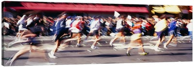 Blurred Motion Side Profile Of Marathon Runners Canvas Art Print