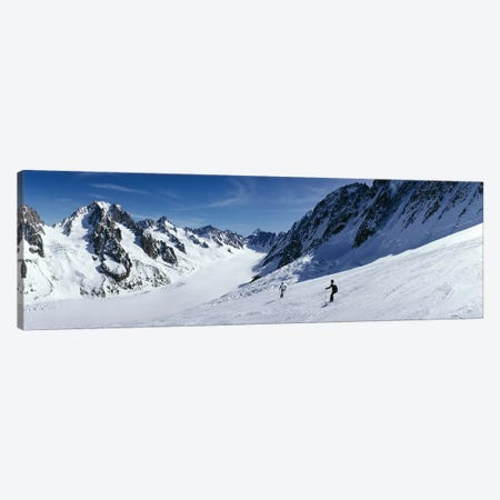 Rear view of two people skiing, Les Grands Montets, Chamonix, France Canvas Print #PIM12255} by Panoramic Images Art Print