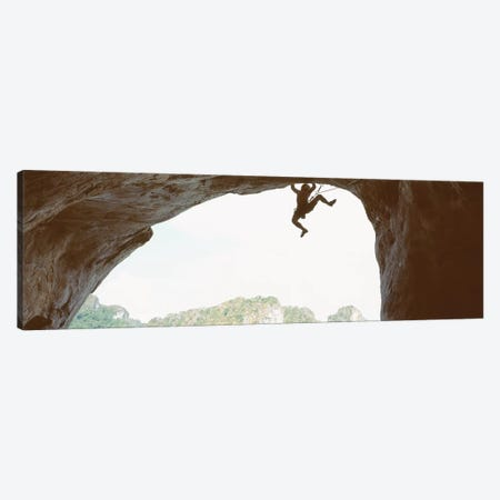Silhouette Of A Man Climbing A Rock, Railay Beach, Krabi, Thailand Canvas Print #PIM12278} by Panoramic Images Canvas Art