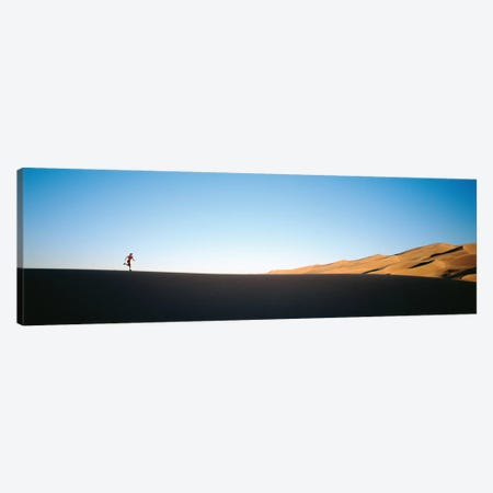 Low angle view of a woman running in the desert 2, Great Sand Dunes National Monument, Colorado, USA Canvas Print #PIM12287} by Panoramic Images Canvas Art