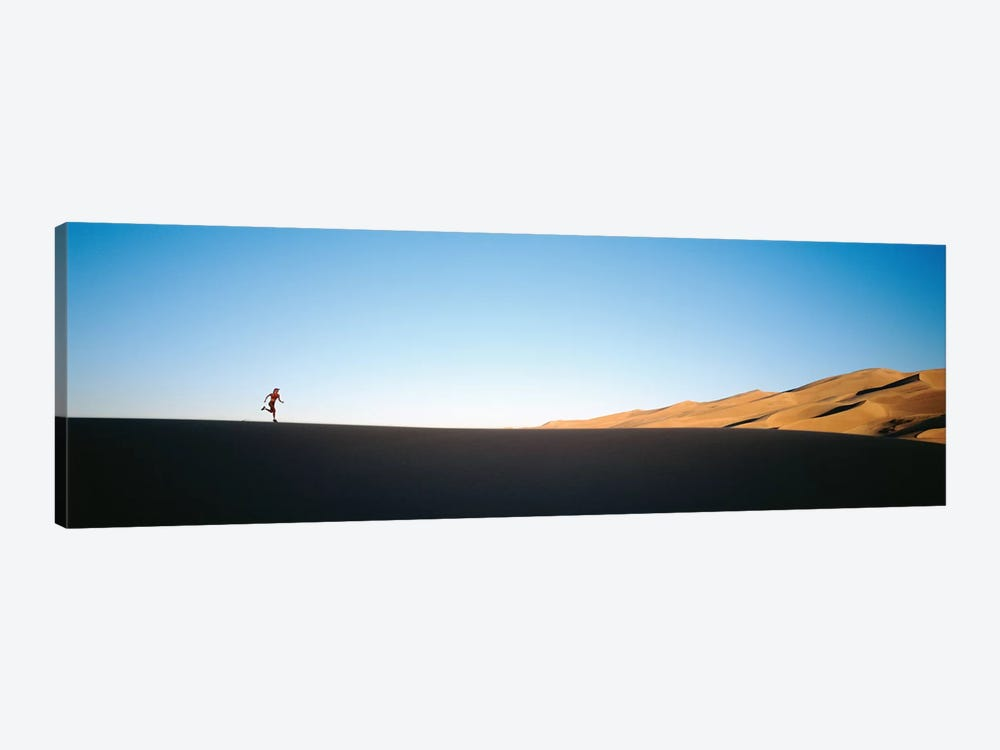 Low angle view of a woman running in the desert 2, Great Sand Dunes National Monument, Colorado, USA by Panoramic Images 1-piece Canvas Art